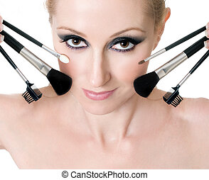 Female face with cosmetic makeup brushes - Makeup brushes...