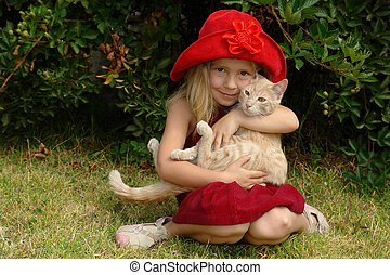 the girl in red hat with a cat
