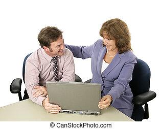 Job Well Done - A businesswoman congratulating her colleague...