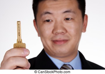 People with Key - Asian businessman holding a key.