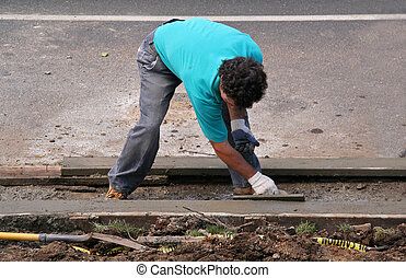 Construction Worker Cementing Curb