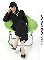 Business Woman - Young woman in business suit sitting in...