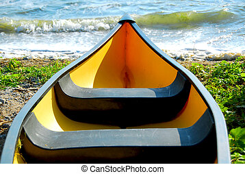 Yellow boat - Yellow canoe on lake shore