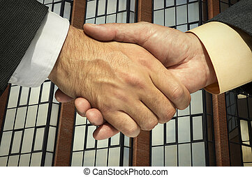 handshaking - Two businessmen shaking hands