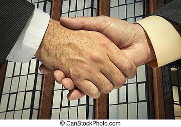 handshaking - Two businessmen shaking hands (photo f/x)