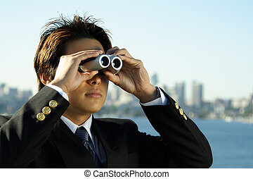 Business vision - Businessman with binoculars, can be used...