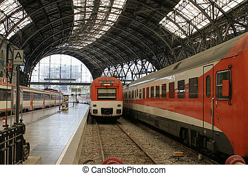 Barcelona train station - train entering Barcelona train...