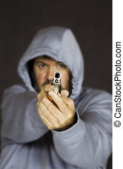 Gun - Model Release 355 Man holding gun in a threatening...