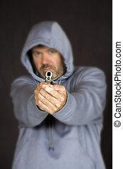 Gun - Model Release 355 Man holding a gun in a threatening...