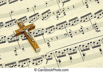 Gospel - Crucifix on top of Sheet Music