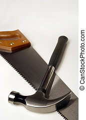 Hammer and saw - Image of a hammer and saw Focus is on the...