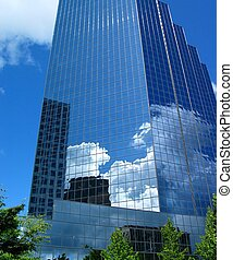 Competing Businesses - Buildings reflected in a blue...