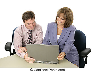 Business Colleagues at Work - A male and female business...