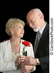 Rose For The Lady - A handsome senior couple in love Hes...
