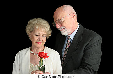Senior Couple on Black - Romantic Gesture - A handsome...