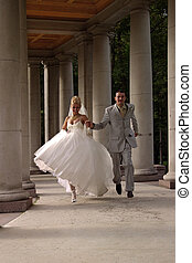 Newly-married couple - The groom and the bride run