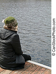Lonely Woman Overlooking Water