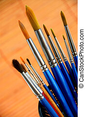 Paintbrushes holder - Paintbrushes in a metal mesh holder