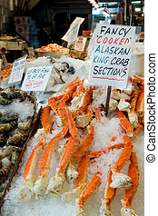 Crab legs - Seafood stand at Seattle Pike place market