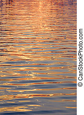 Water surface gold - Background of blue water with golden...