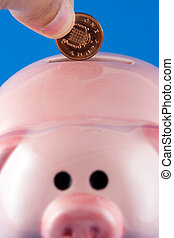 Making a deposit - Putting a penny in a piggy bank