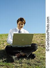 Working businessman - A businessman working on his laptop...