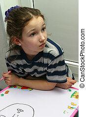 Draws - The girl draws felt-tip pens