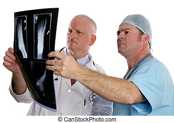 Doctors View Xrays - Two doctors examing the xray of a foot....