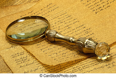 Magnifying Glass - Vintage Brass Magnifying Glass on Top Of...