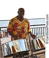 Steel Drummer - A caribbean musician playing steel drums.