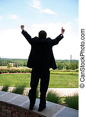Business Man Victory - Business Man with Hand Raised in...