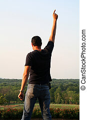 Victory is Mine - Man raising his hand in victory