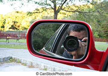 Paparazzi - Man taking photo from car
