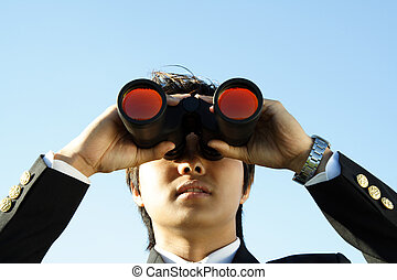 Business vision - Businessman looking through binoculars,...