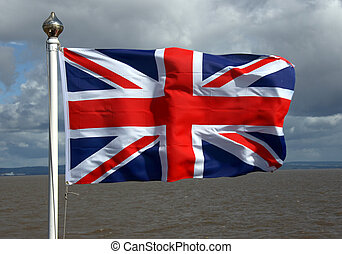 Union Jack Flag - A union jack flag agaonst a sea background