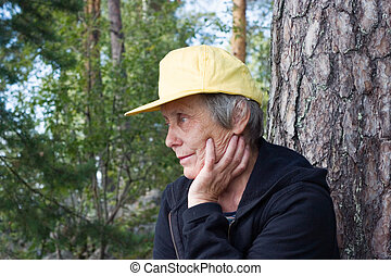 Old woman  in a yellow cap
