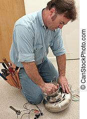 Electrician Assembles Fan Motor