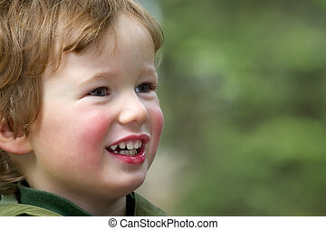 Smiling child on spring walk