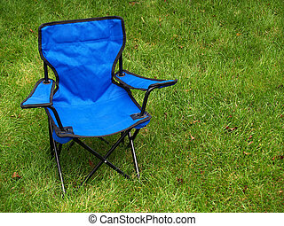 folding camp chair - folding blue camp chair on the lawn