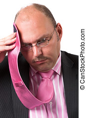Facing problems - Businessman wiping the sweat of his...