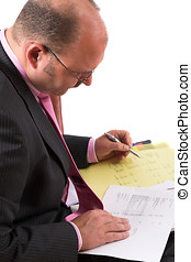 Cost analysis - Businessman making a wage cost analyis...