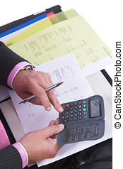 Calculating the costs - Hands of a businessman making...