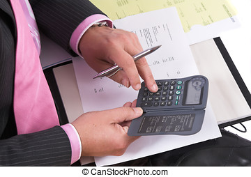 Cost analysis - Businessman making some calculations