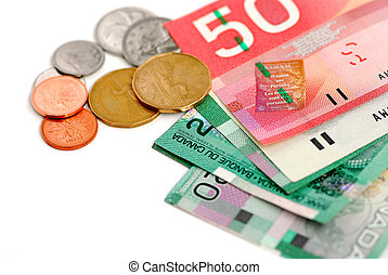 Canada money - Canadian bills and coins on white background