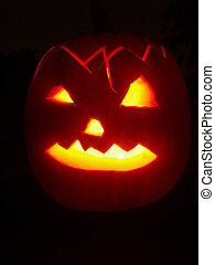 Halloween pumpkin ready for trick-or-treat with candle light...