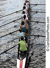Joint effort - women crew team race on river