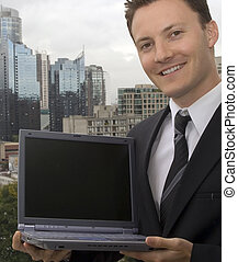 Visit our website - A businessman is showing off a laptop...