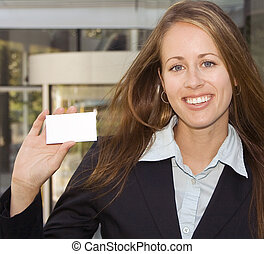 Business Woman - Showing you a business card - A business...