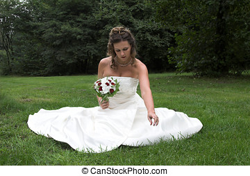 Bride in the park - Beautiful bride sitting in the park
