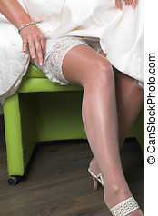 Sexy legs - Bride showing the stockings on her leg